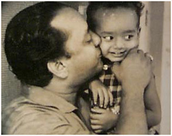 Taufiq getting a peck from his illustrious father in his nappy days